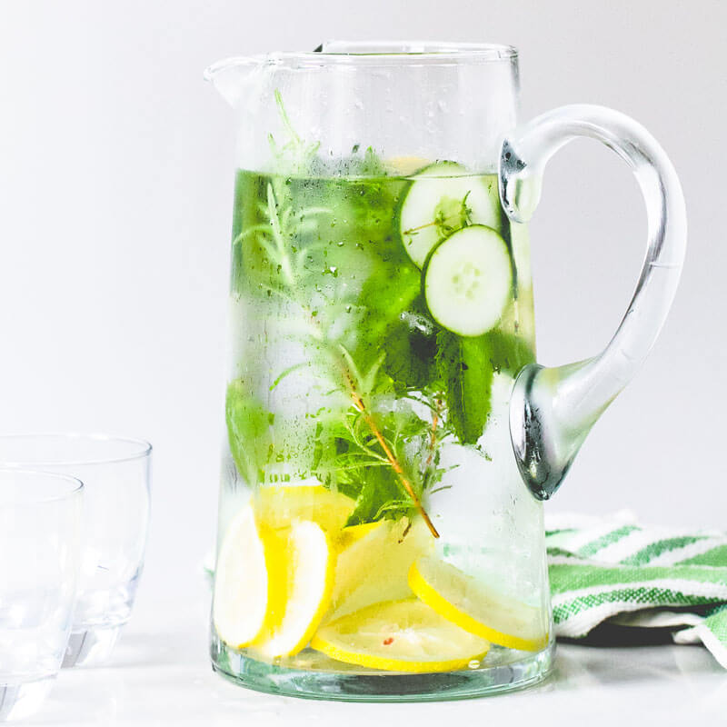 A jug of water, flavoured with rosmary, cucumber and lemon.